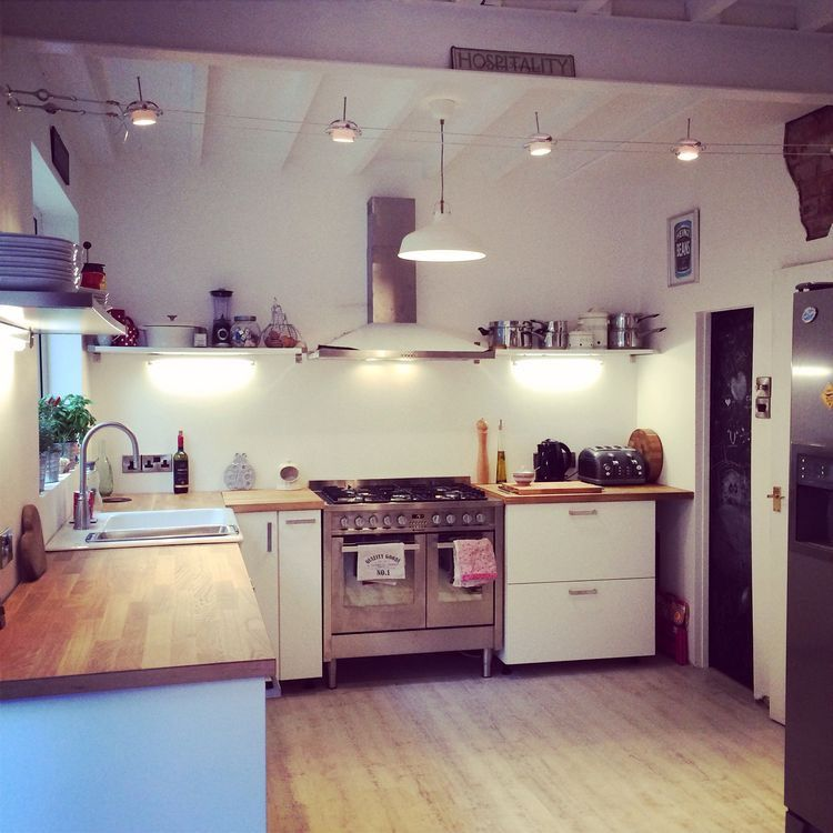 light  airy kitchen open plan industrial style  home