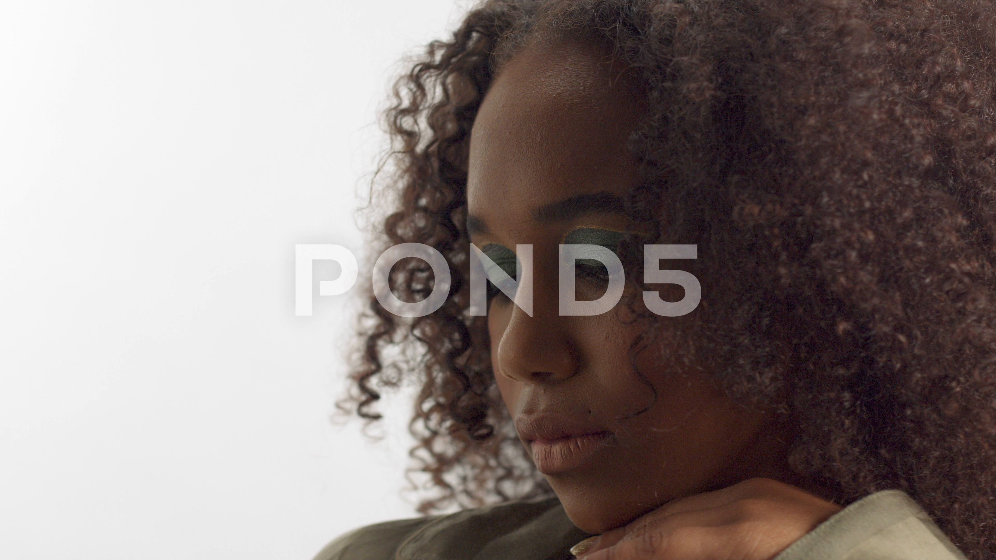 Young Mixed Race Model In Studio On White With Curly Hair Bright Green Eye Stock Footage Ad Model Studio White You Curly Hair Styles Mixed Race Models Hair