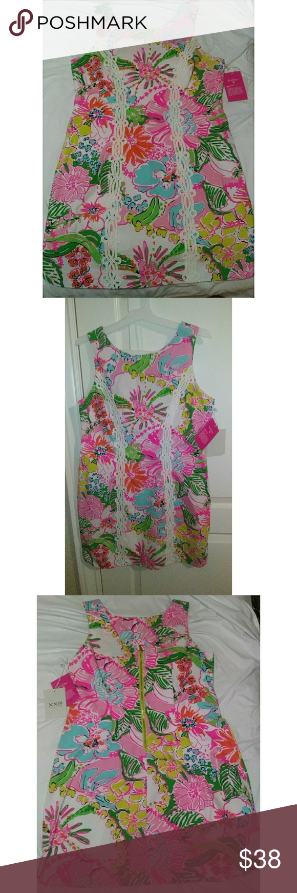 Lily Pulitzer Nosey Posie dress Nosey Posie Mini Shift dress Target Collaboration Year 2015 for 2019. 20 Years of design for All Two decades ago, Target was first to bring great designs to everyone through exclusive partnerships with amazing designers. Now we're celebrating by bringing back 20 of our most-loved moments.  Hand-painted prints define the iconic Lily Pulitzer look, in clothing designed for a vacation state of mind. Our 2015 Lily Pulitzer for Target collection celebrated Lily's Palm  #minimomentcelebrations