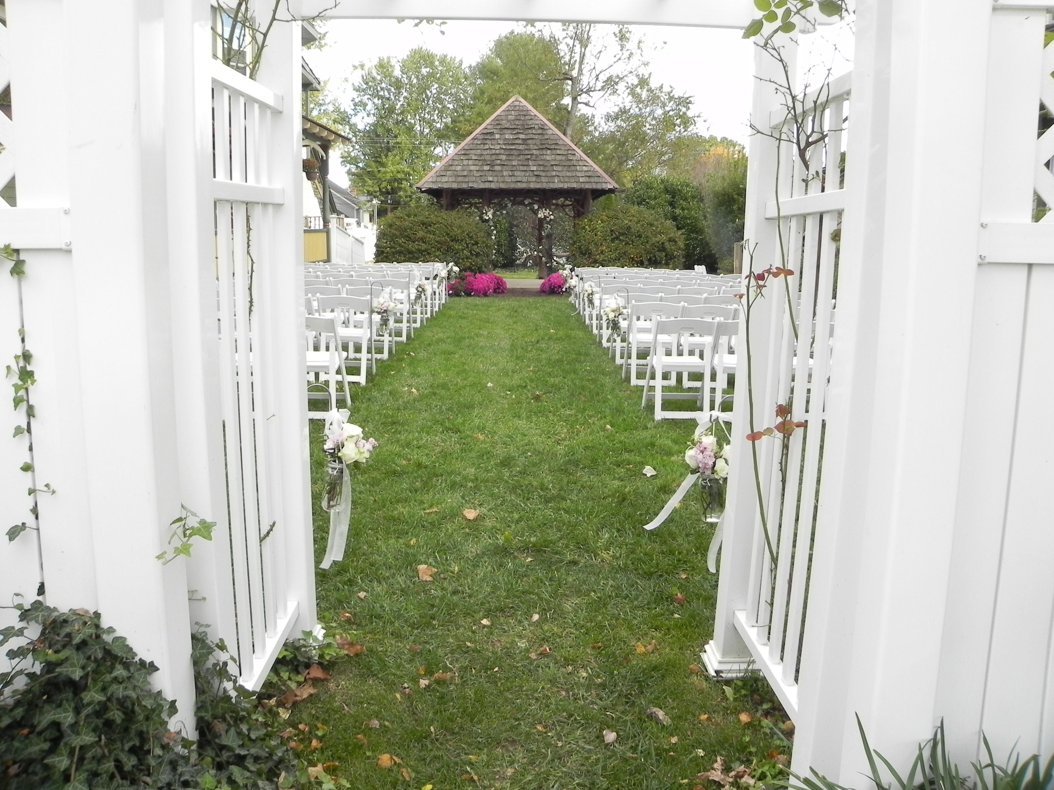 Looking Through The Arch At The Entrance To The Aisle At Vandiver Inn Havre De Grace Md Www Perryhallflorist Com Rustic Wedding Havre De Grace Wedding Venues