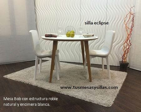 mesa redonda de estilo nordico Bob ondarreta y sillas eclipse de ...