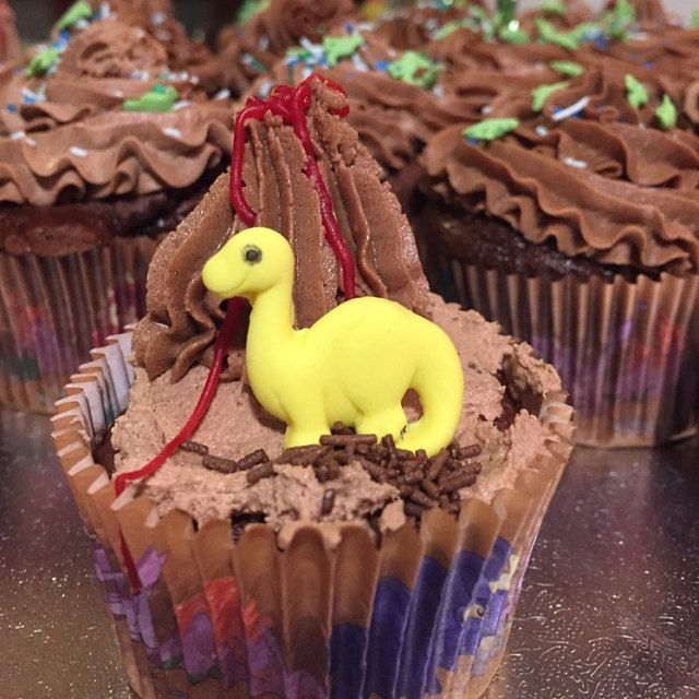 Dinosaur party cupcake fondant toppers.  Hand made cake decorations