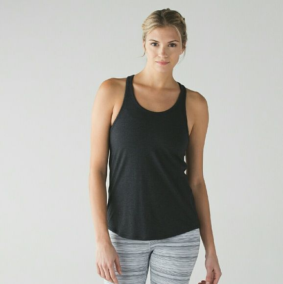 Lululemon Yogi everyday tank small black like new designed for: yoga, fabric(s): Pima Cotton, fit: loose, length: hip lululemon athletica Tops Tank Tops