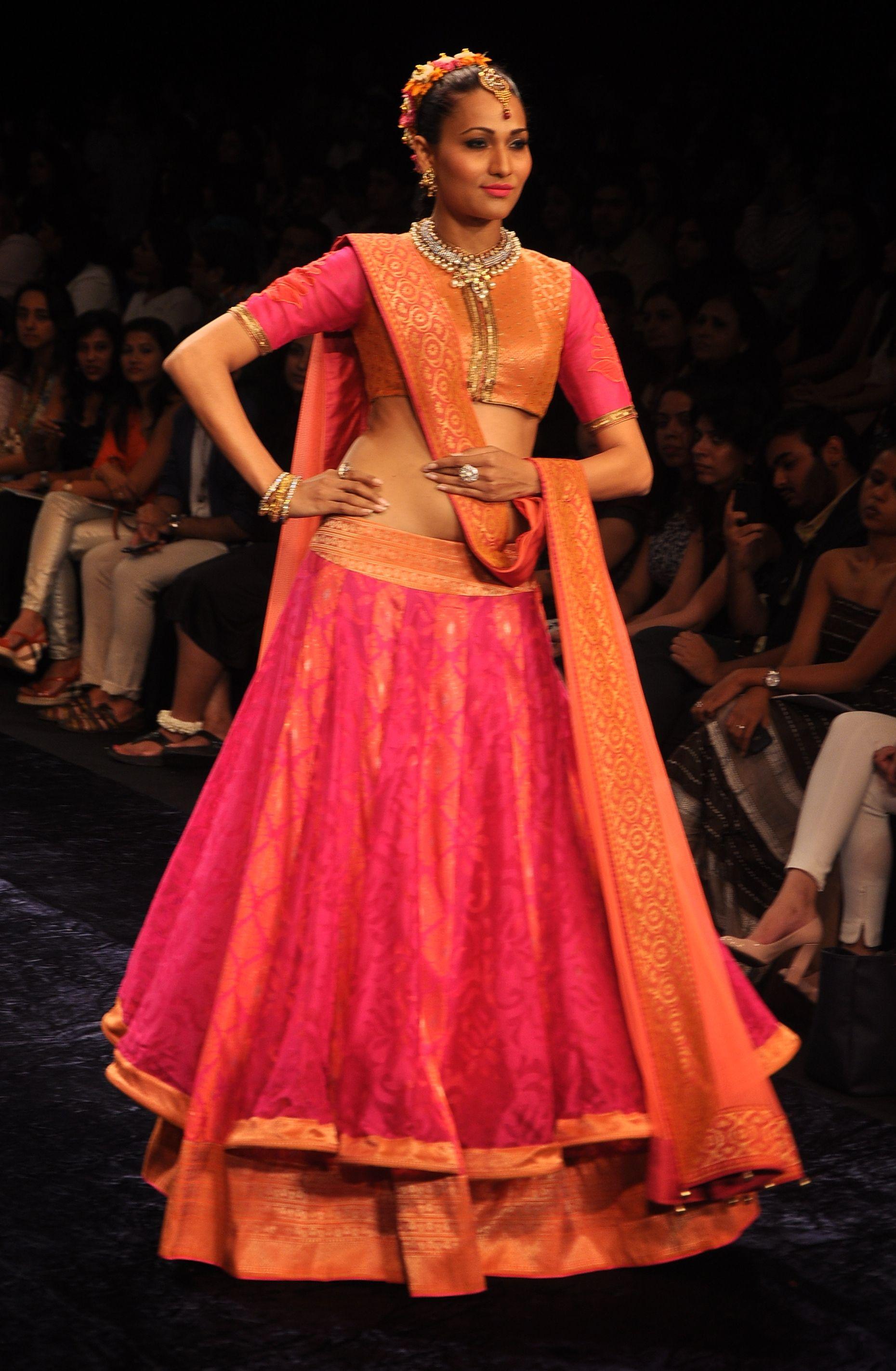 d88d8a861382 Pink net lehenga with an orange and pink brocade blouse and orange dupatta. Neeta  Lulla
