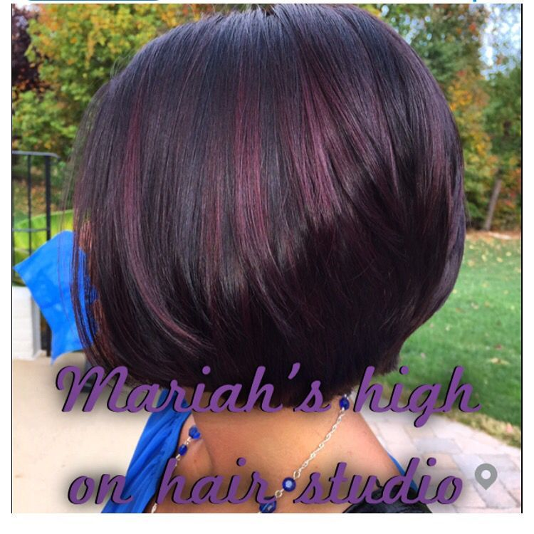 Dark brown hair with balayage red violet on short bob haircut
