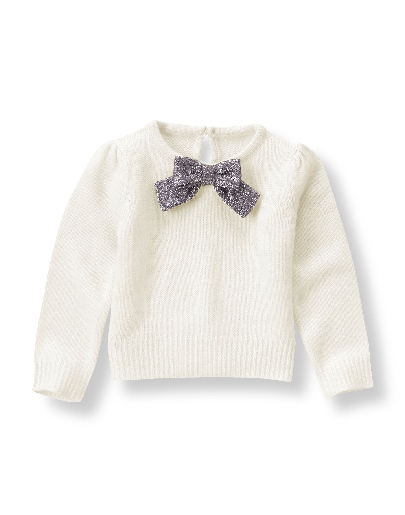 Our soft and cozy sweater twinkles with a metallic purple bow detail.