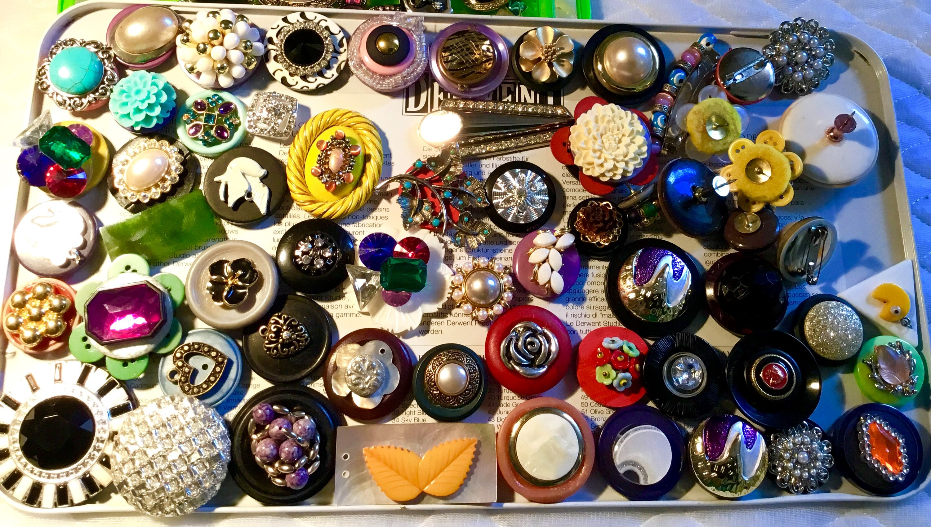 Mixed media old, vintage and a few new pieces, magnets, hair clips , pushpins, and brooches