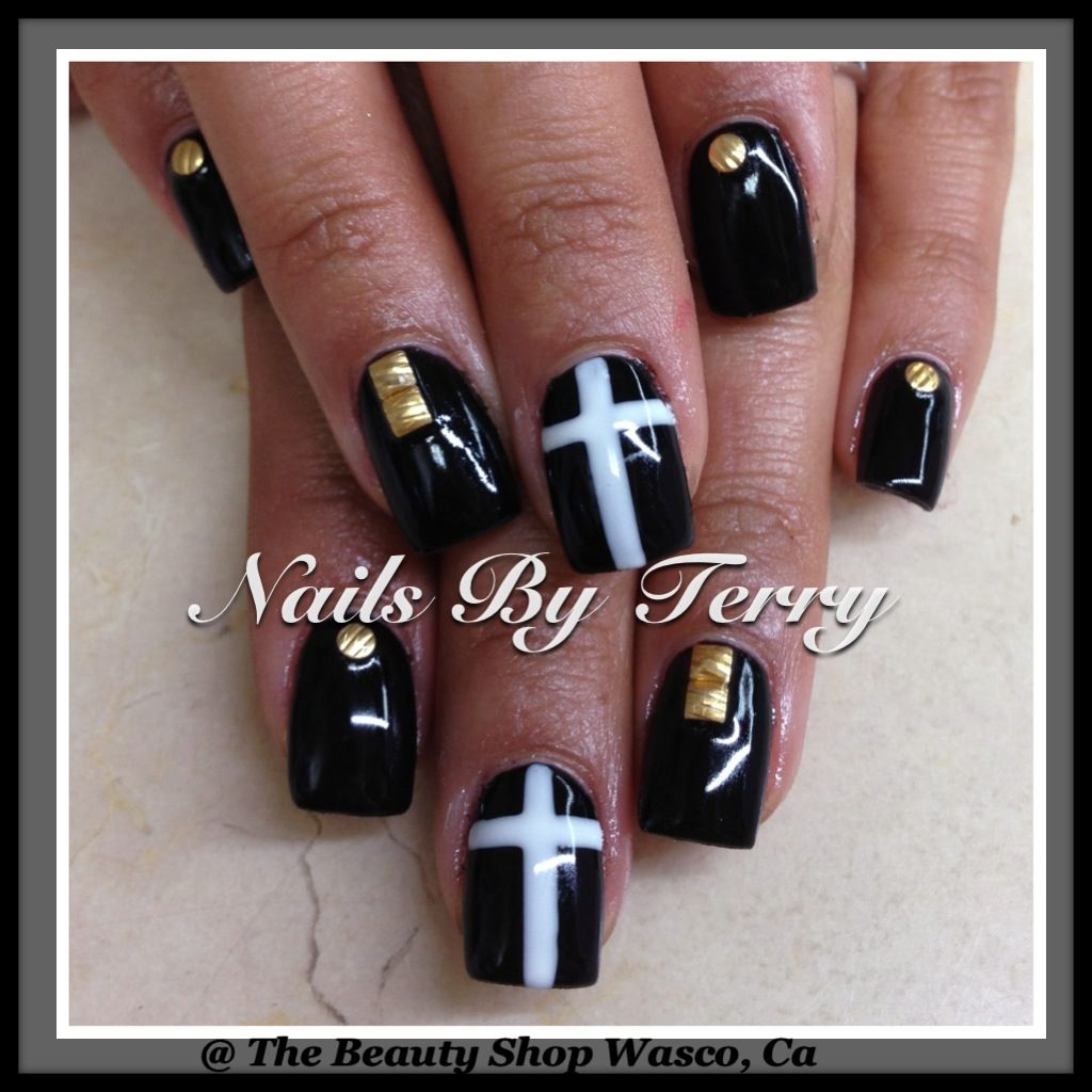 Black gels with studs and cross