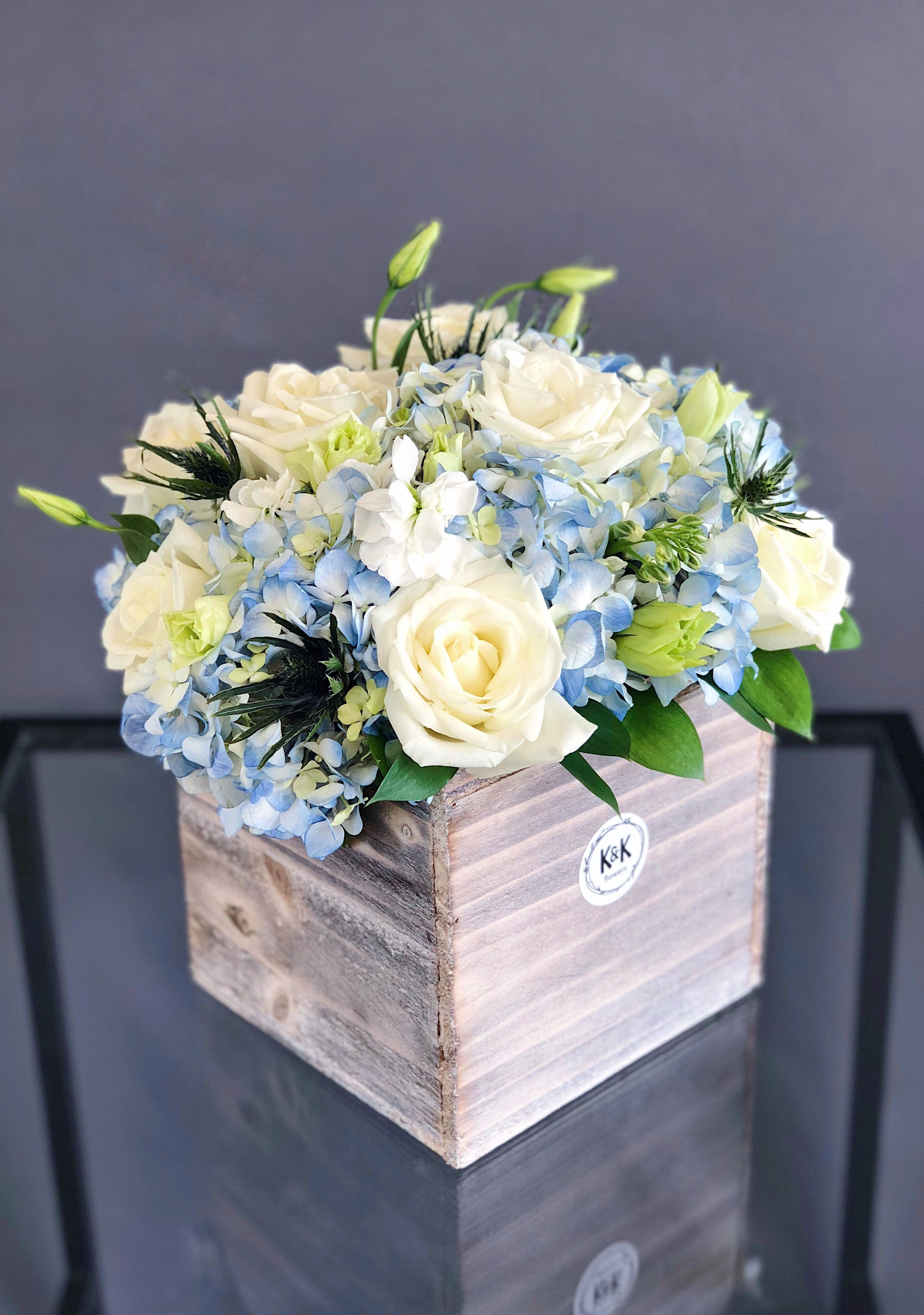 Large Wood Box Arrangement For A Table With White Roses Blue Hydrangeas And Wh Blue Flower Arrangements Blue Flower Centerpieces Beautiful Flower Arrangements