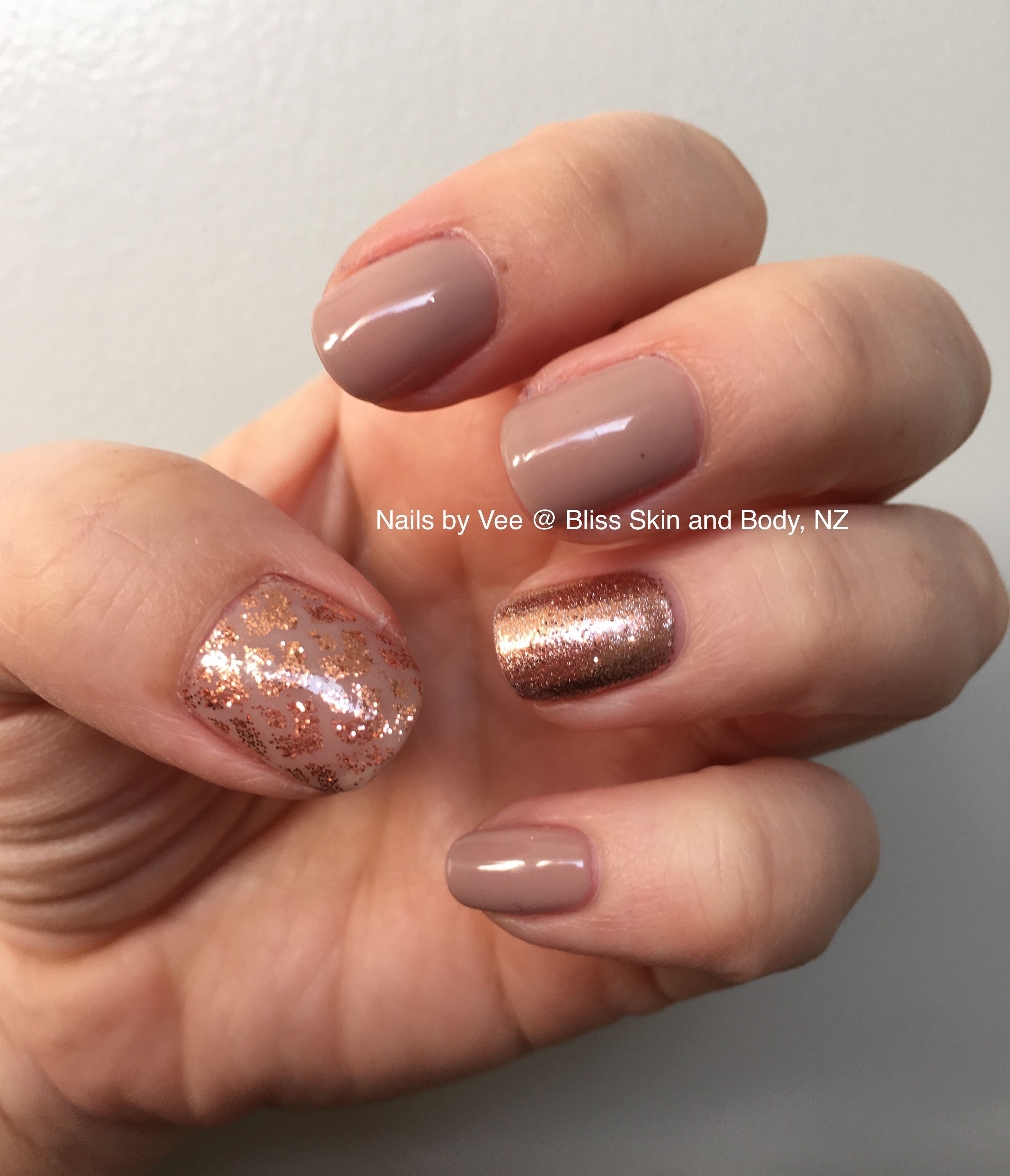cnd shellac field fox with rose gold glitter feature nails