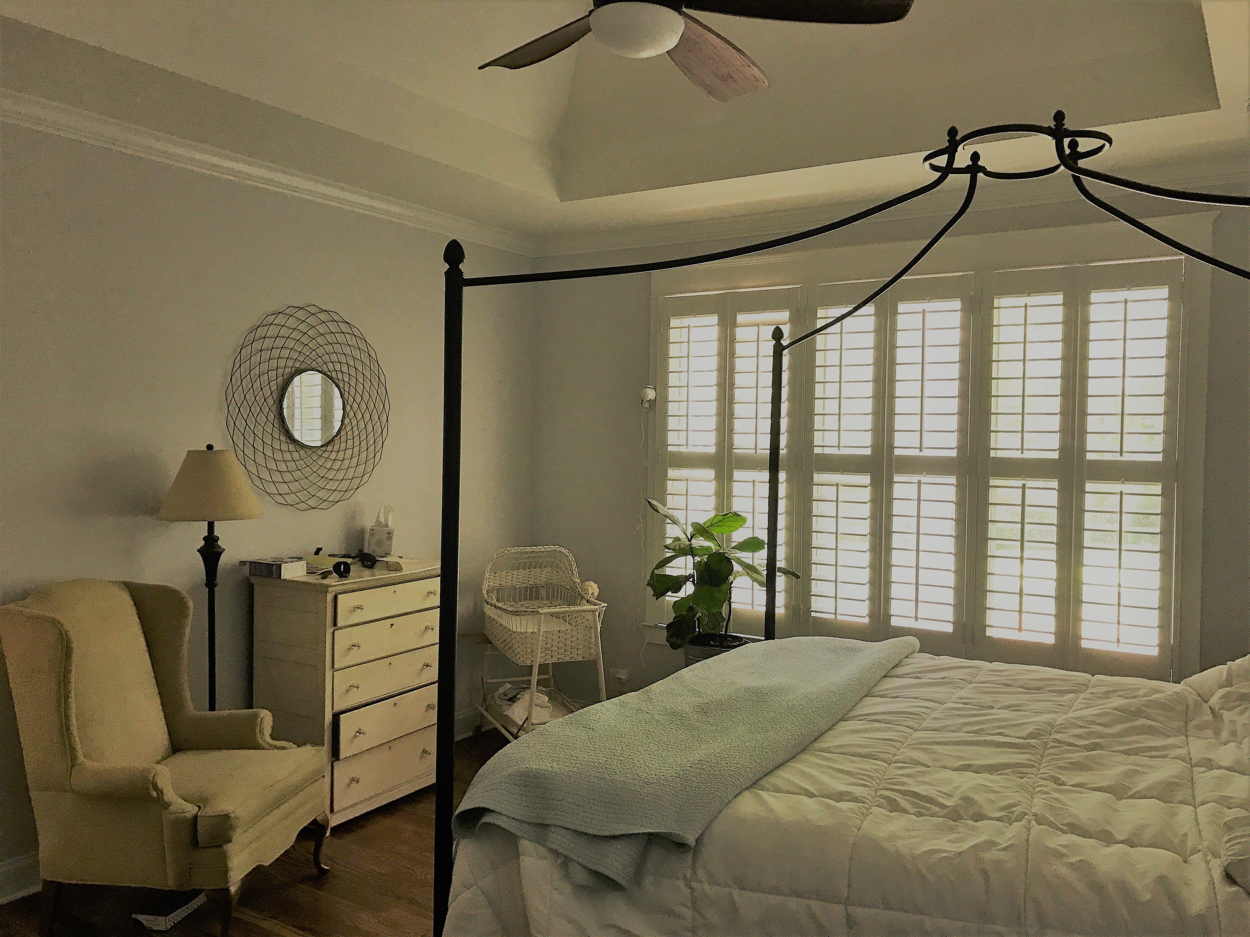 Castleberry custom shutters installed in the master bedroom shared