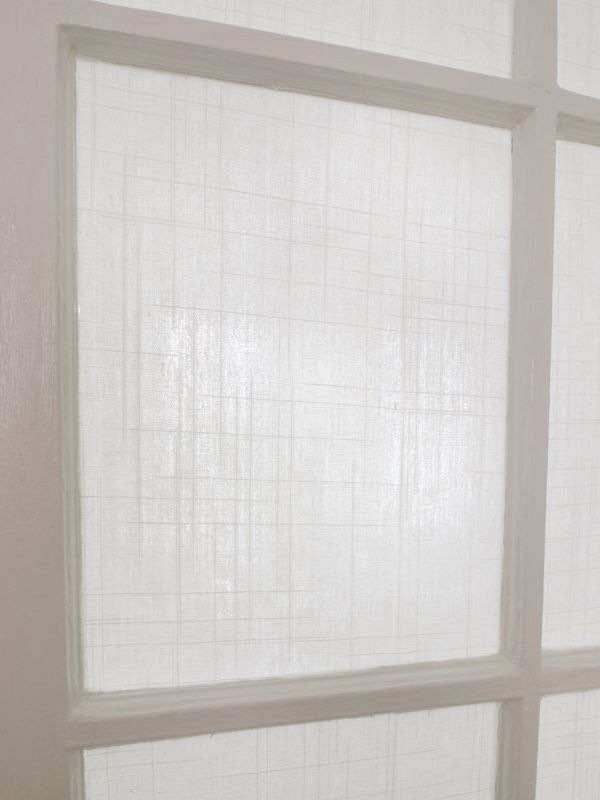 applying fabric with cornstarch on glass for privacy way classier than film diy window