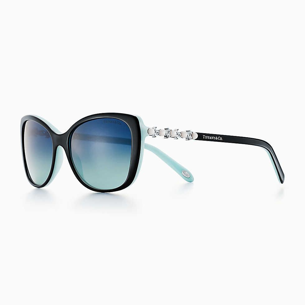 7866ef5b5f0 What woman wouldn t want a pair of these   Tiffany Aria adagio cat-eye  sunglasses in black and Tiffany Blue acetate.