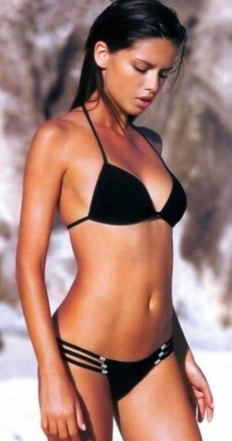 Bikini babe in a black bikini! Hottest babe ever, until she smiles! haha :)
