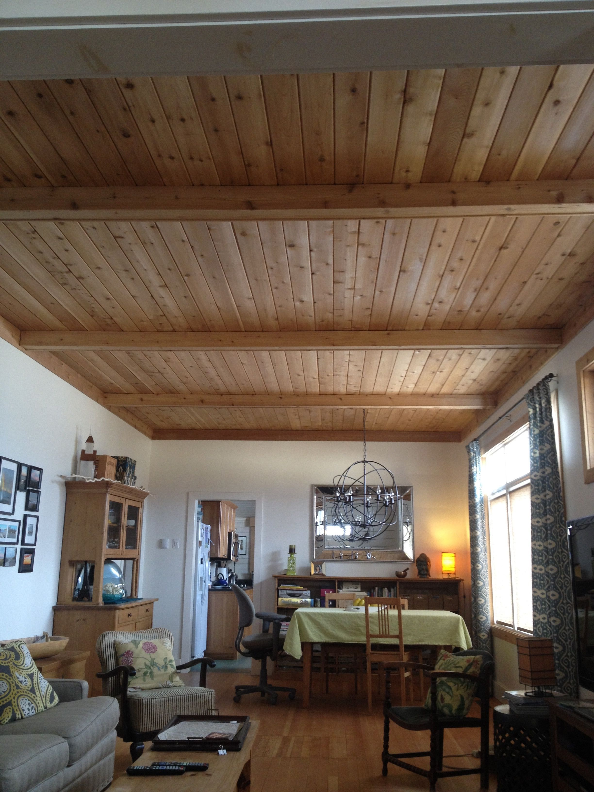 Ceiling cedar plank ceiling in cottage with false beams