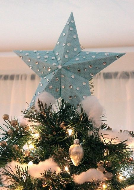 DIY tree topper Hmmm hole punch to let the light shine through - decorative christmas trees