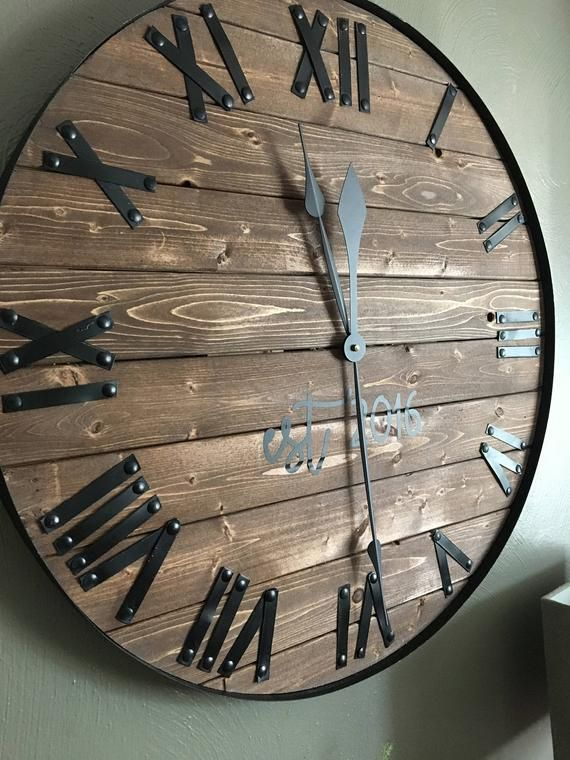 24  Oversized Wall Clock, Farmhouse Clock, Barn wood Wall Clock, Rustic Clock, Farmhouse Decor, Wood Wall Sign, Anniversary Gift, Customized is part of Clock Wall decor - silentmechanismupgrade Clock Hands   The hands we use are made from metal  Due to the mechanism, the hands must be a lightweight metal in order for the mechanism to be able to hold and move the hands  Because of this, the hands are pliable  We package the hands detached from the clock in order to keep them as safe as possible and to limit damage to both the mechanism and the hands  Upon installation, in the event the hands are angled in a way which causes them to catch on one another, the hands can be easily bent back or smoothed out by hand  This is a normal occurrence and is an easy fix! Message us at any time upon the delivery of your clock and we can walk you through the process!  Stain Color Please know that every piece of wood handles stain differently  Two pieces of the same type of wood will react to a stain differently  It adds to the uniqueness of the piece! Because of this we cannot guarantee a perfect match but will do our best  Customization   You can add as much or as little custom lettering to your clock  The customized lettering is done in a high quality vinyl  Once your order is placed, we will send you over font samples to choose from  Once you choose a font (or a couple if you can't decide!) We will create proofs for you to look at  We will work together to create the look you are wanting!