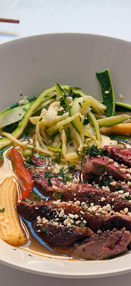 Ginger and garlic infused beef broth with sliced organic beef steak and nutrient packed courgetti noodles, a lighter and healthier alternative to starchy noodles.