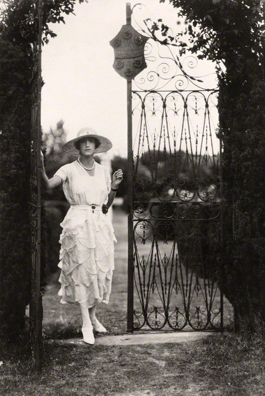 Sybil (nee Sassoon), Marchioness of Cholmondeley photographed by Cecil Beaton in the gardens at Houghton Hall, Norfolk, late 1920s