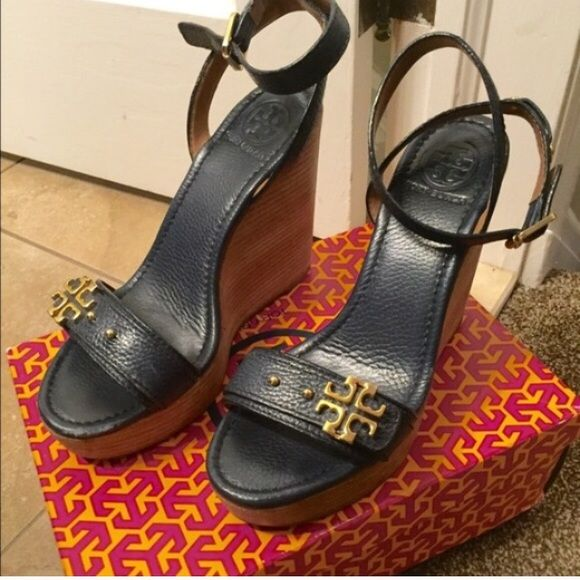 Tory burch wedges Dark blue wedges , come with box . Only worn a few times a little scuff on front of shoe . Tory Burch Shoes Wedges