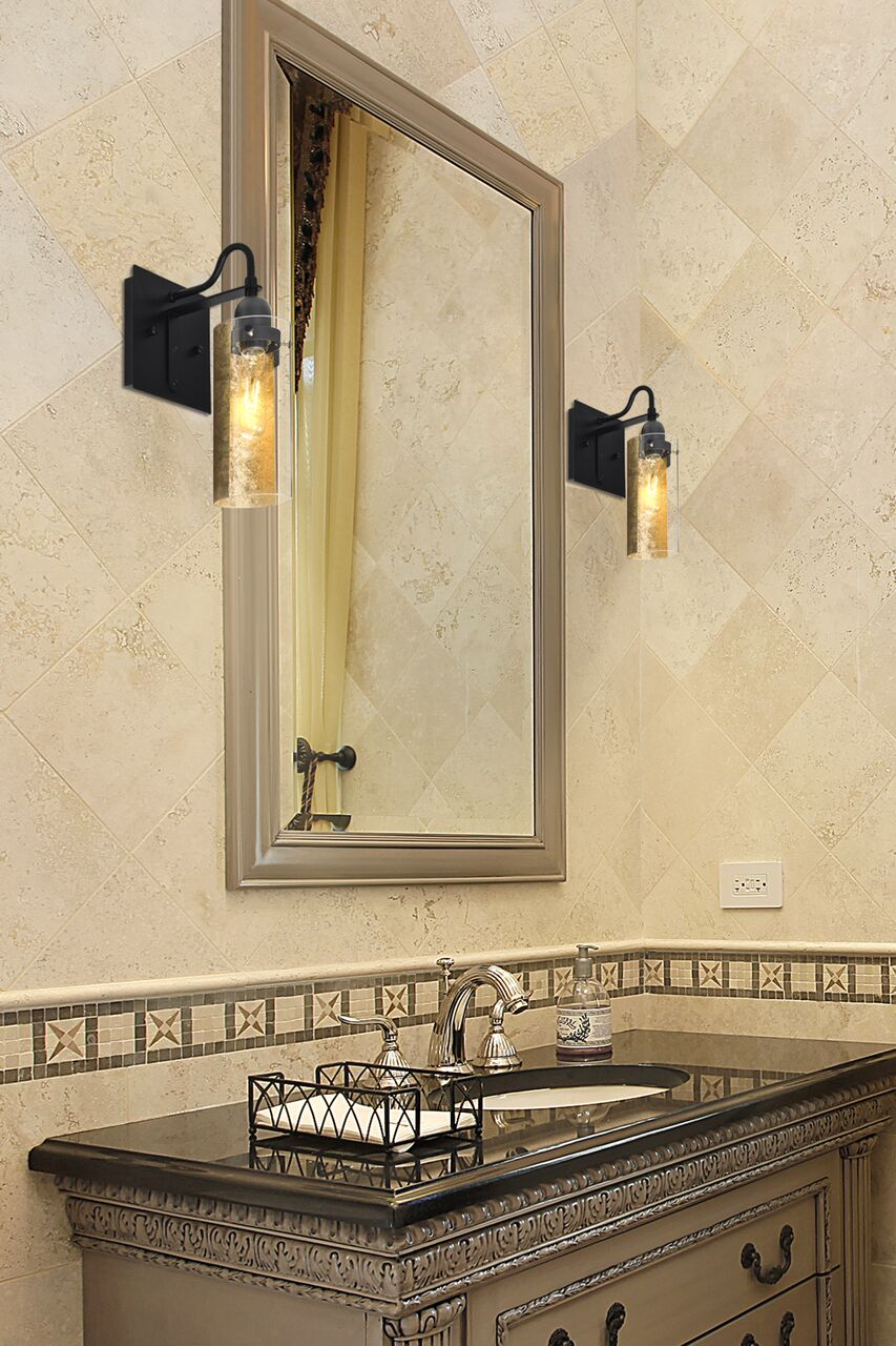 The Duke is a transitional bath design composed of a copper foil backed glass cylinder, with a compelling textured metallic effect that plays off the gleam of the clear glass component. Mounted off the broad canopy with timeless gooseneck socketholder, the pleasing glow from each shade's gold foil make for a striking affect along with the prominent display of the lamp filament behind the glass.    Visit our website to learn more about Duke.