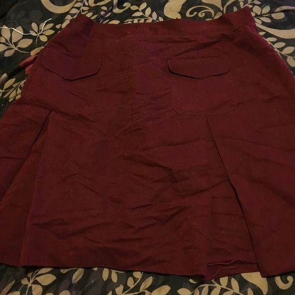 Burgundy mini shirt 2 pockets in front  and button in back Newport News Skirts Mini