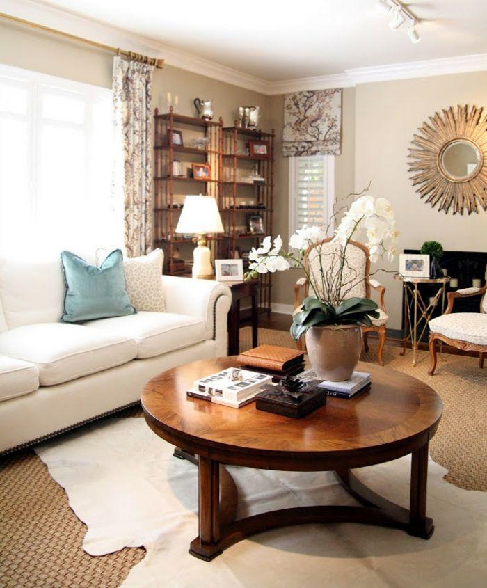 Wohnzimmer Deko Ideen ein runder Couchtisch aus Holz mit einer - wohnzimmer dekorieren ideen
