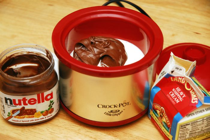 Nutella Fondue: 1/2 cup Nutella / 1/2 cup heavy whipping cream / Mix ingredients together and heat them on low, stirring often.