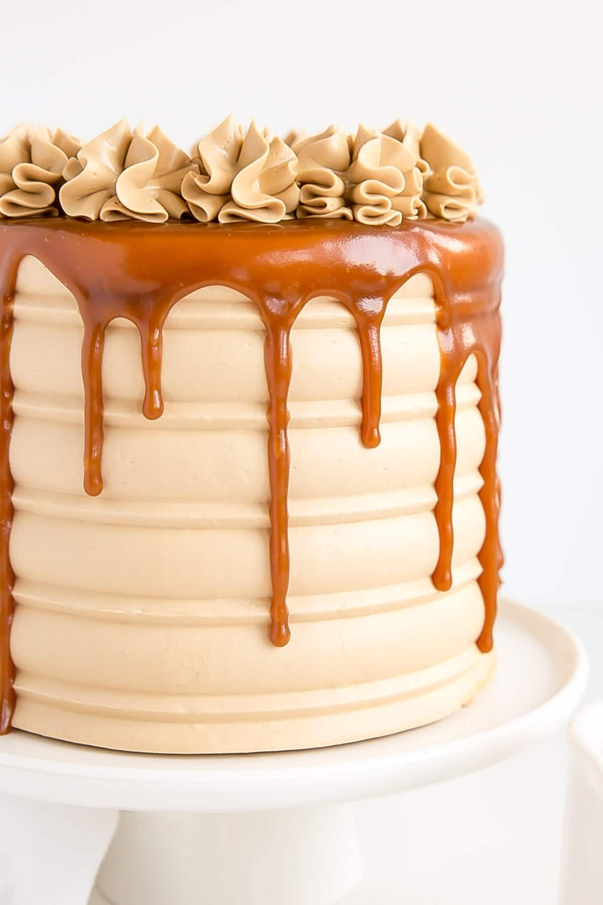 Close up of a caramel cake showing textured sides and a