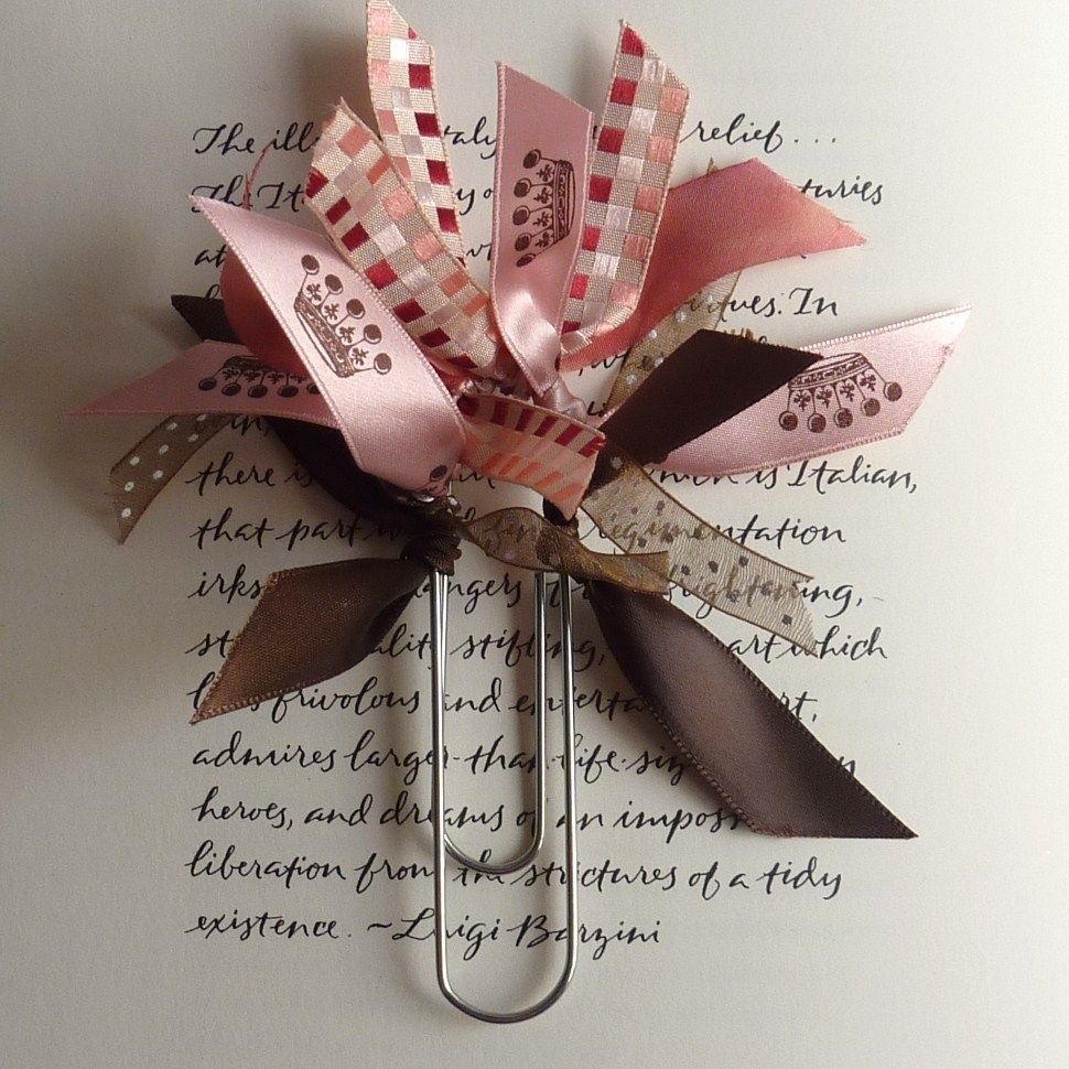 You tie ribbons onto the closed end of a paper-clip and use it as a ...