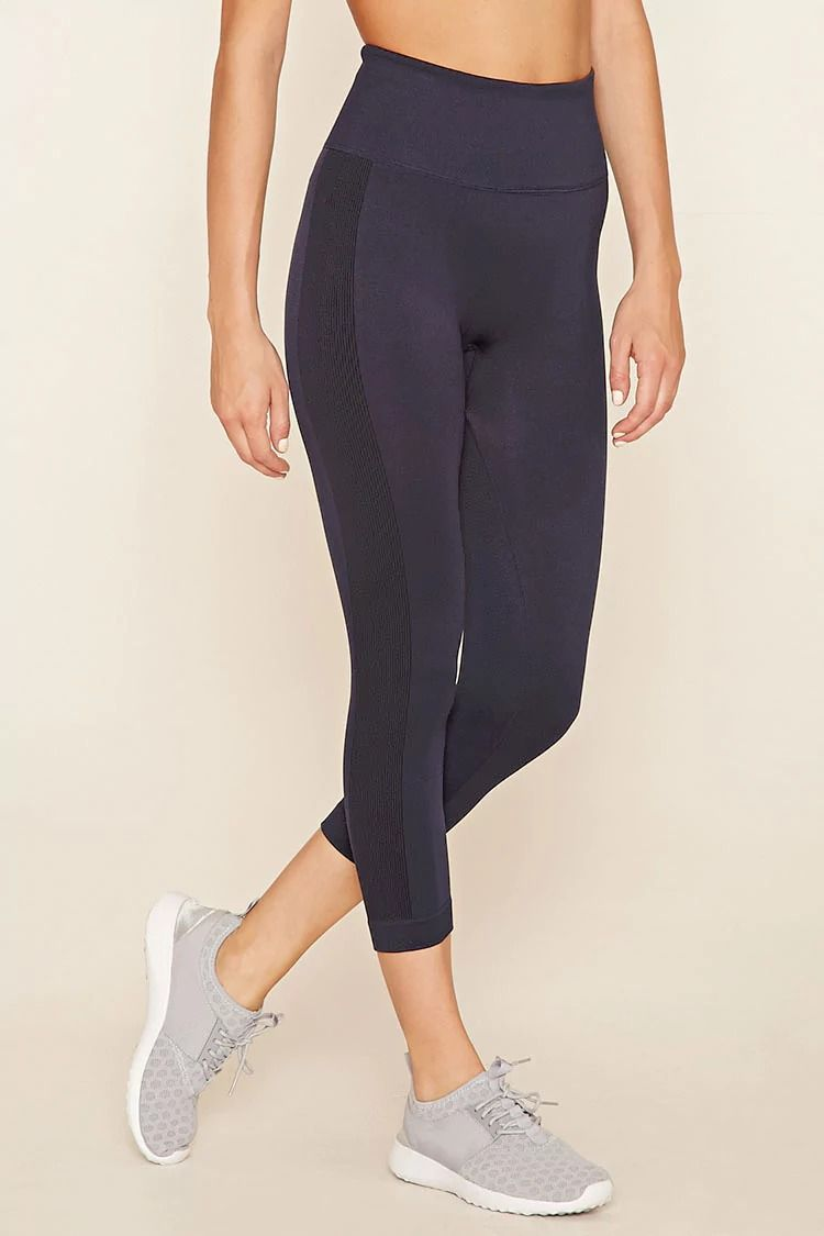 In a comfortable stretch knit, these athletic capri leggings feature contrast vertical lines going down the side of each leg, and moisture management. #f21active