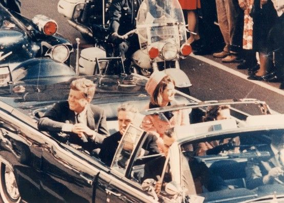 While travelling with his wife as well as the governor of Texas, Governor John Conally and his wife in the presidential limousine, JFK was fatally shot.