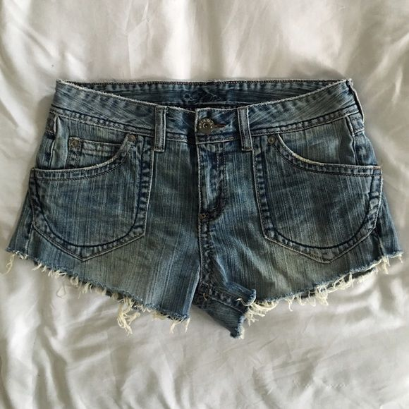 Piama cut off denim jean shorts Piama cut off denim jean shorts. Size 9. Distressed. Needs a fly button which is an easy fix. Spot by back pocket may or may not be a problem. Both are pictured. Price reflects this. Piama Shorts Jean Shorts