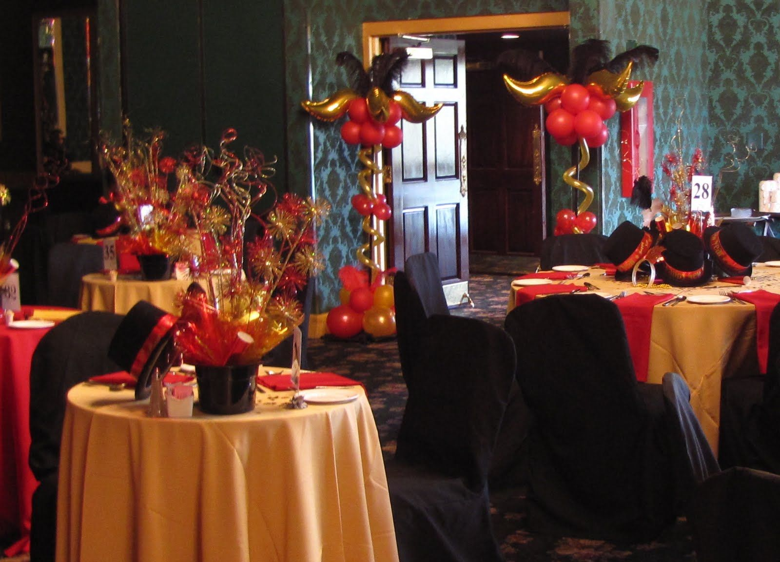 Curves And Feathers Columns Created To Match Red Gold Black Decor In The Ballroom