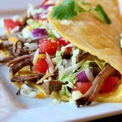 Green Chile Beef Tacos - Allrecipes.com.  This is a great recipe!  I add a couple of jalapeños for added flavor.