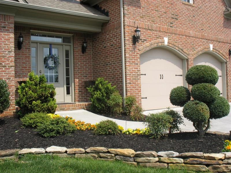Keystone brick accents with arch brick over garage doors for Brick homes with stone accents
