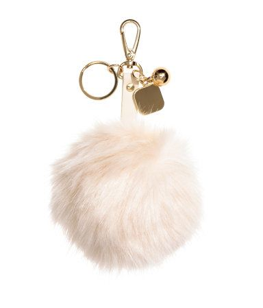 Black white. Key ring in metal and plastic with a large faux fur pompom f331c8ec9740f