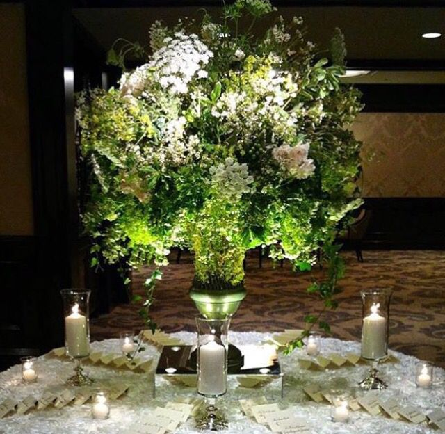 Green and white entryway floral by HMR Designs