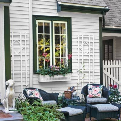 Add texture to siding with trellises, and draw attention to windows with boxes filled with bright blooms.    Similar to shown: Dura-Trel Cambridge 6-foot Vinyl Arch Trellis, about $70, and Rectangle Wood Nantucket Standard Window Box in white, about $70; Hayneedle