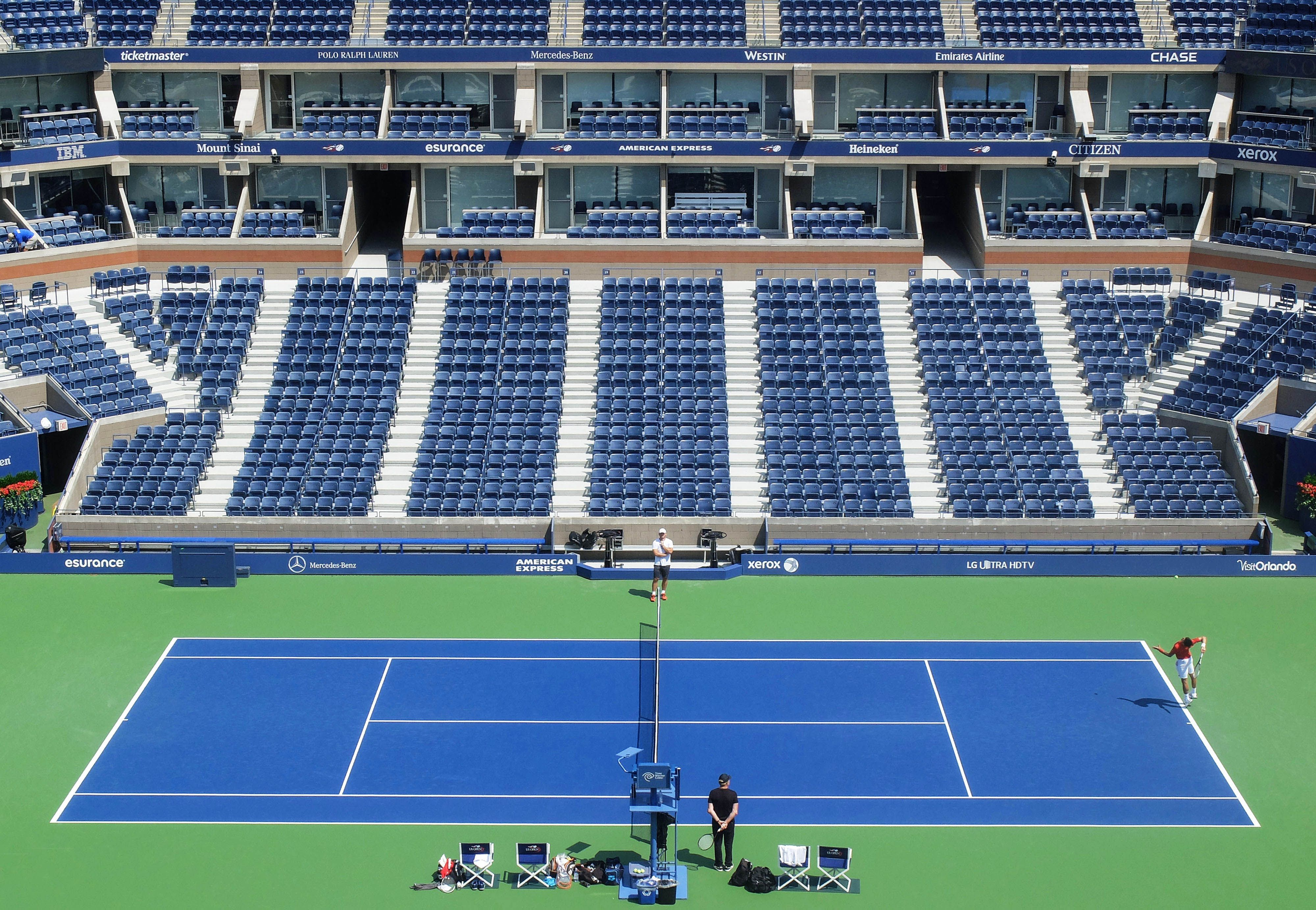Djokovic Practices His Serve In Arthur Ashe Stadium With Images Professional Tennis Players Tennis Championships Tennis Court