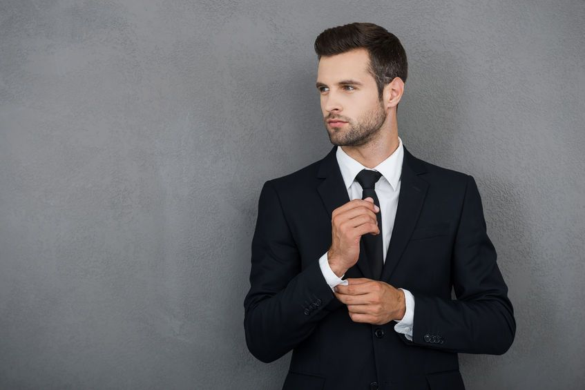 44203290 - perfect to the last detail. handsome young businessman adjusting  his sleeves while standing · Online Dating ProfileBlog ...