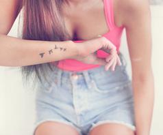 Bird tattoo on side arm