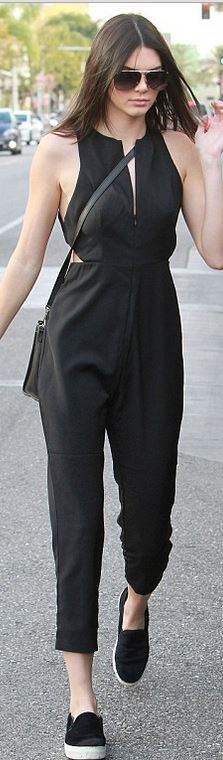 Kendall Jenner's black slit jumpsuit, sneakers, and handbag street fashion style