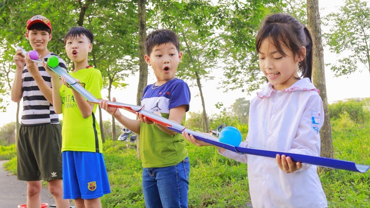 Kids Play Team Building Game Slide Balloon Kids go to