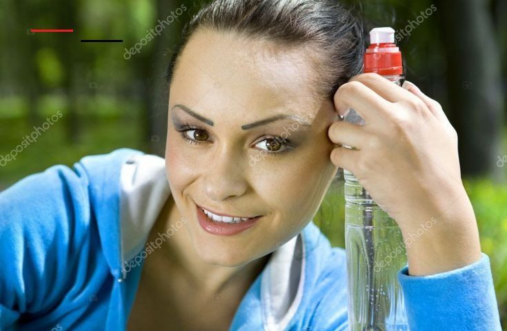 Pretty young girl runner in the forest with bottle of water   Royalty-Free Images, stock photography...