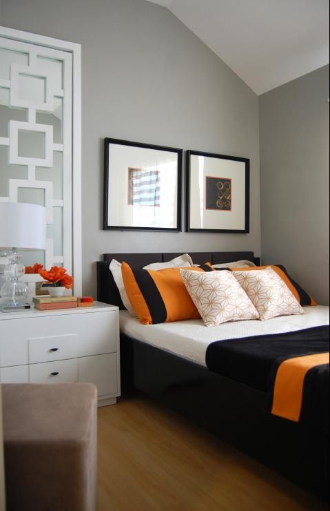 Orange  Gray room A bedroom painted with gray shades accentuated - Orange Bedrooms