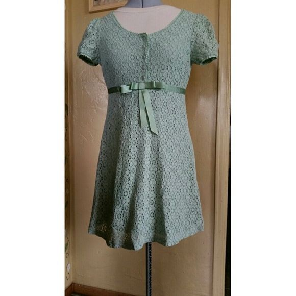 Mint green Lace Dress Fully lined except on sleeves. 55% cotton 45% polyester. Zipper on back. It measures approximately 30 inches from shoulder to bottom of dress. Empire waist (below bust and above waist)  measurement is 28 1/4 inches. It doesn't stretch. Sleeves are 12 inches around and have elastic and stretches up to 17 1/2 inches. Umgee USA Dresses
