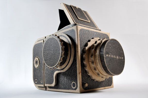 Pinhole Hasselblad    Screen-printed corrugated cardboard Hasselblad designed to function as a pinhole camera and accept 120 film.