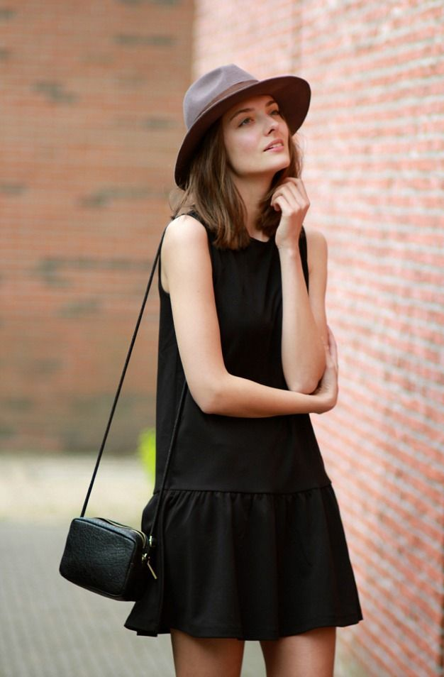 Structured hat with a loose dress