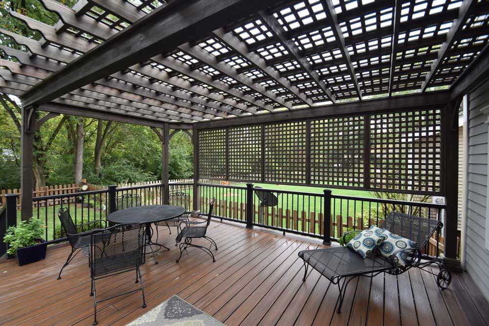 Charcoal Black Wood Pergola Lattice Roof Privacy Wall. Featuring impressive  columns and topped with an - Charcoal Black Wood Pergola Lattice Roof Privacy Wall. Featuring
